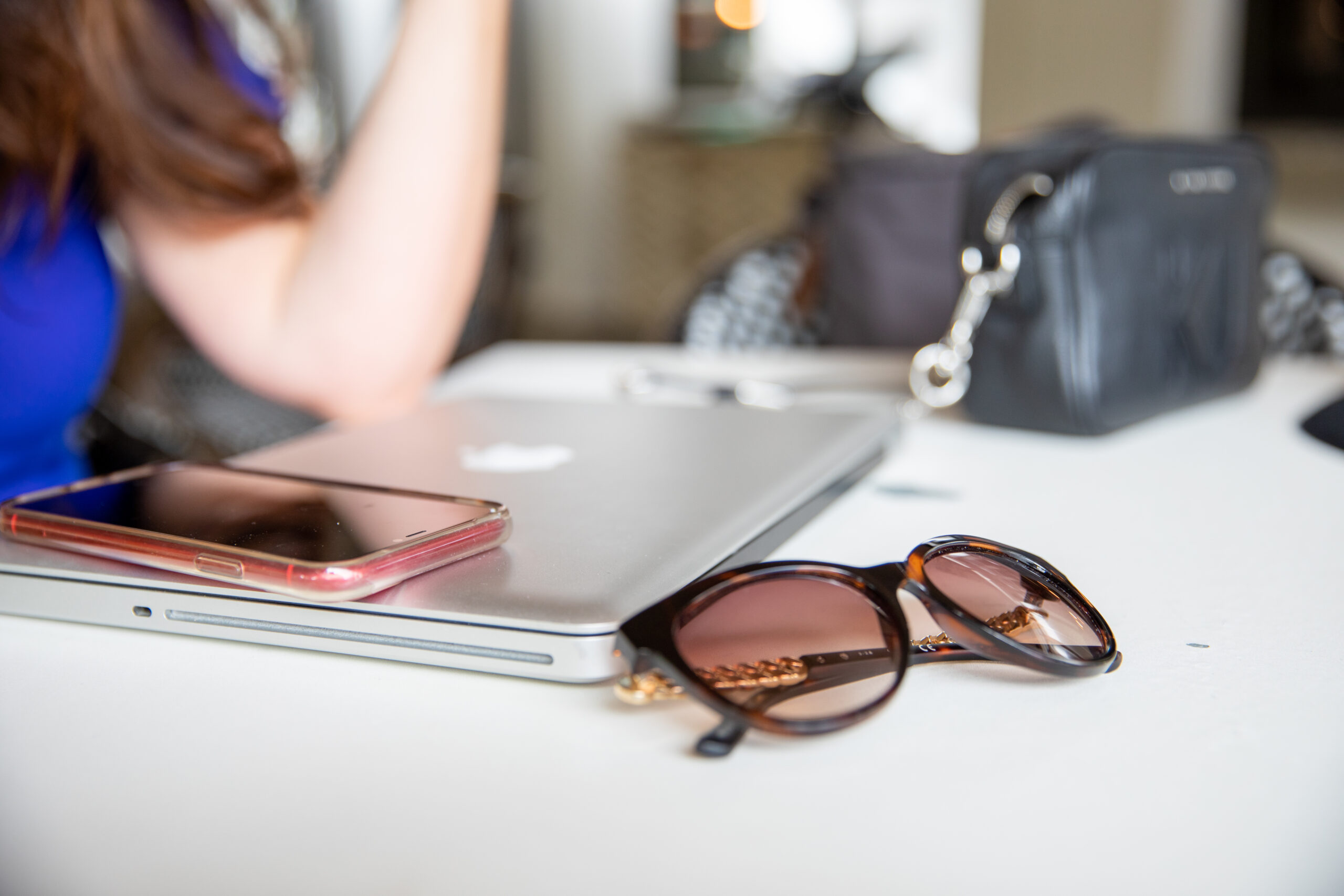 laptop phone sunglasses