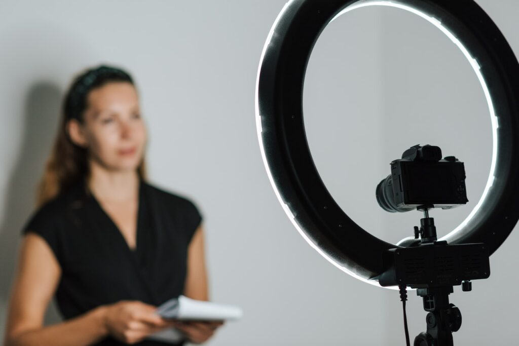 woman in front of camera and light