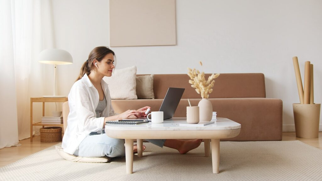 Woman on laptop in calm setting