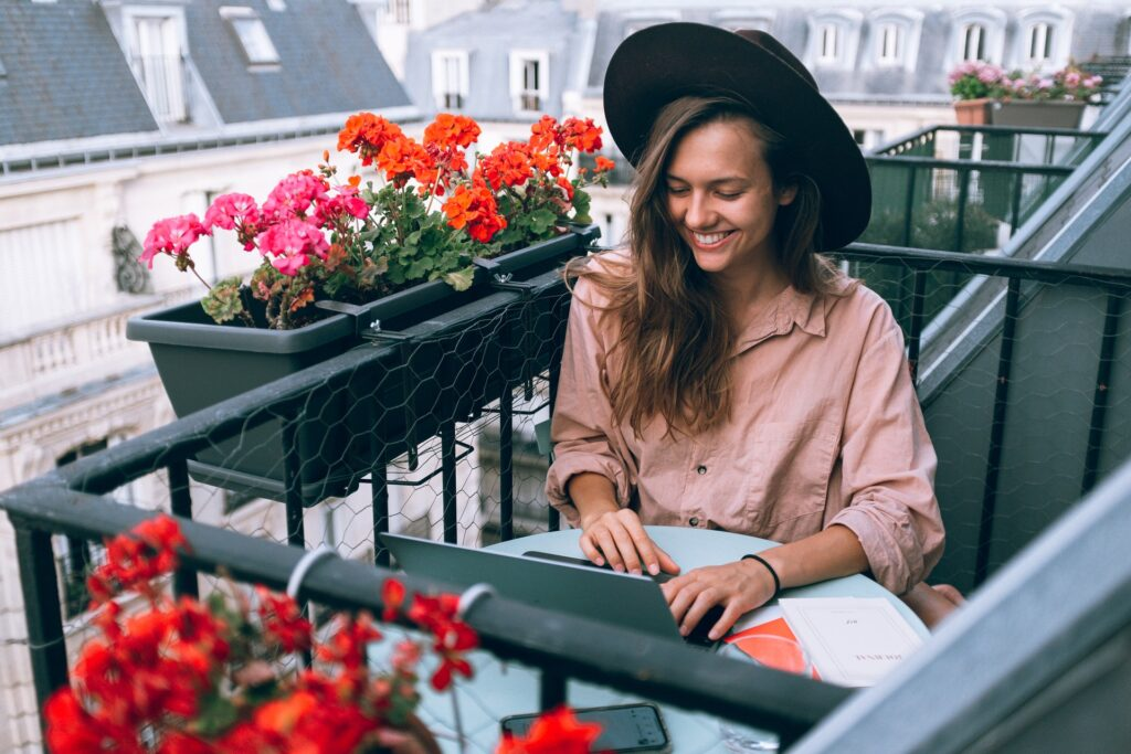 woman smiling typing into laptop