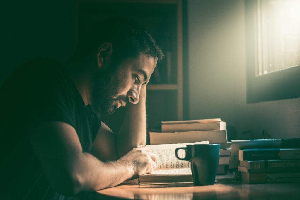 Man staring at an open book