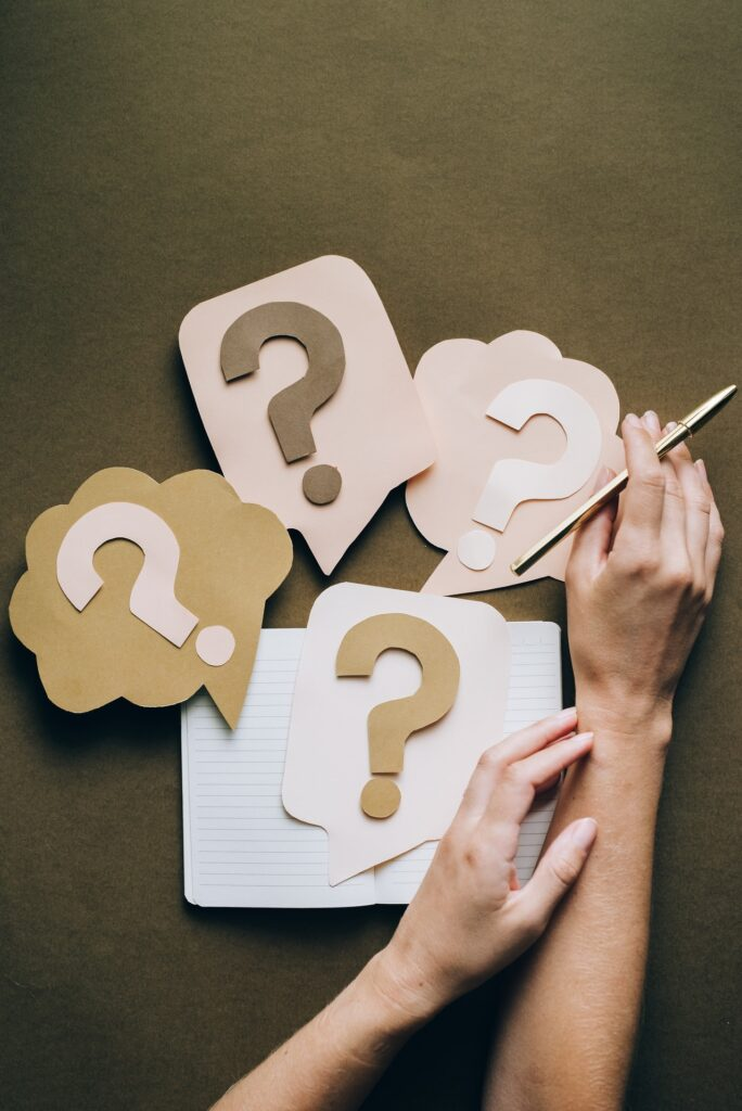 question marks on colourful paper