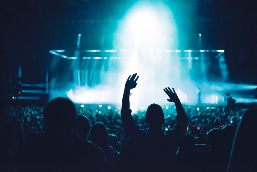 audience with hands up at a concert